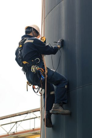 Male worker rope access inspection
